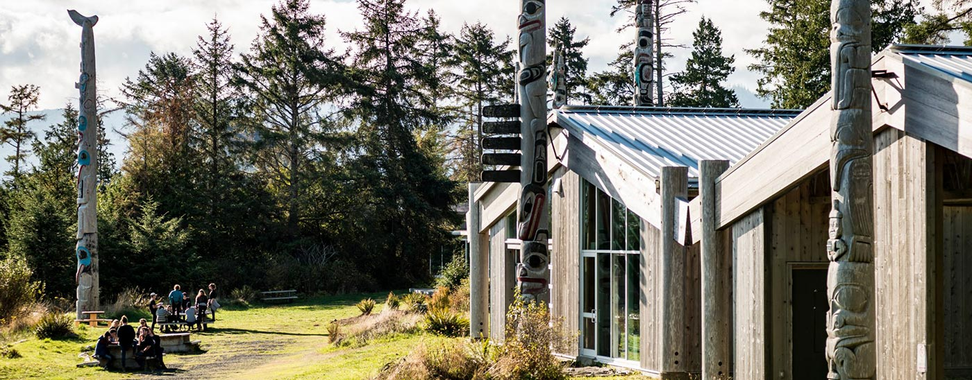 Photo of the buildings and totem poles at Haida Gwaii