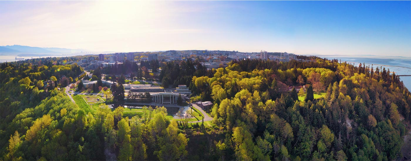 Widescreen aerial shot of UBC's Vancouver Campus during the late summer with the Museum of Anthropology in the foreground
