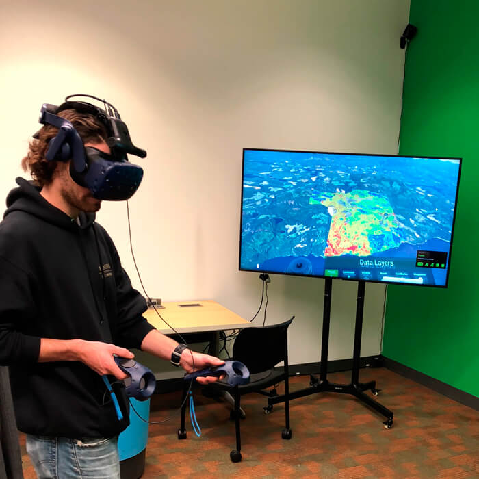 Virtual Reality. Student interacting with TimberOps VR Immersive Analytics Platform