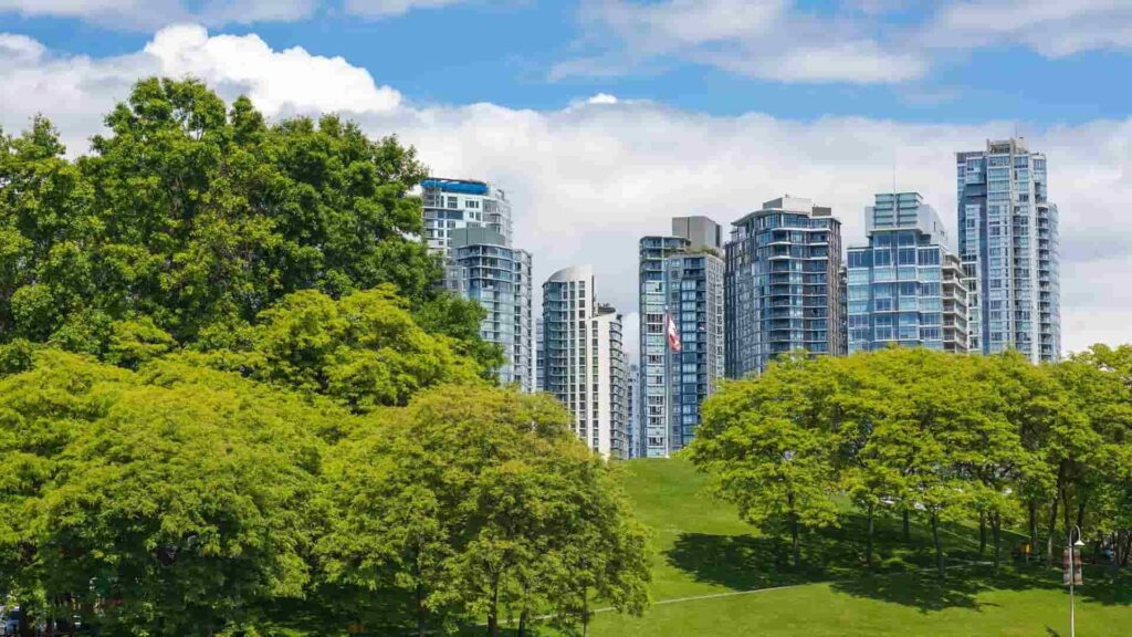Vancouver urban buildings with green trees in the foreground