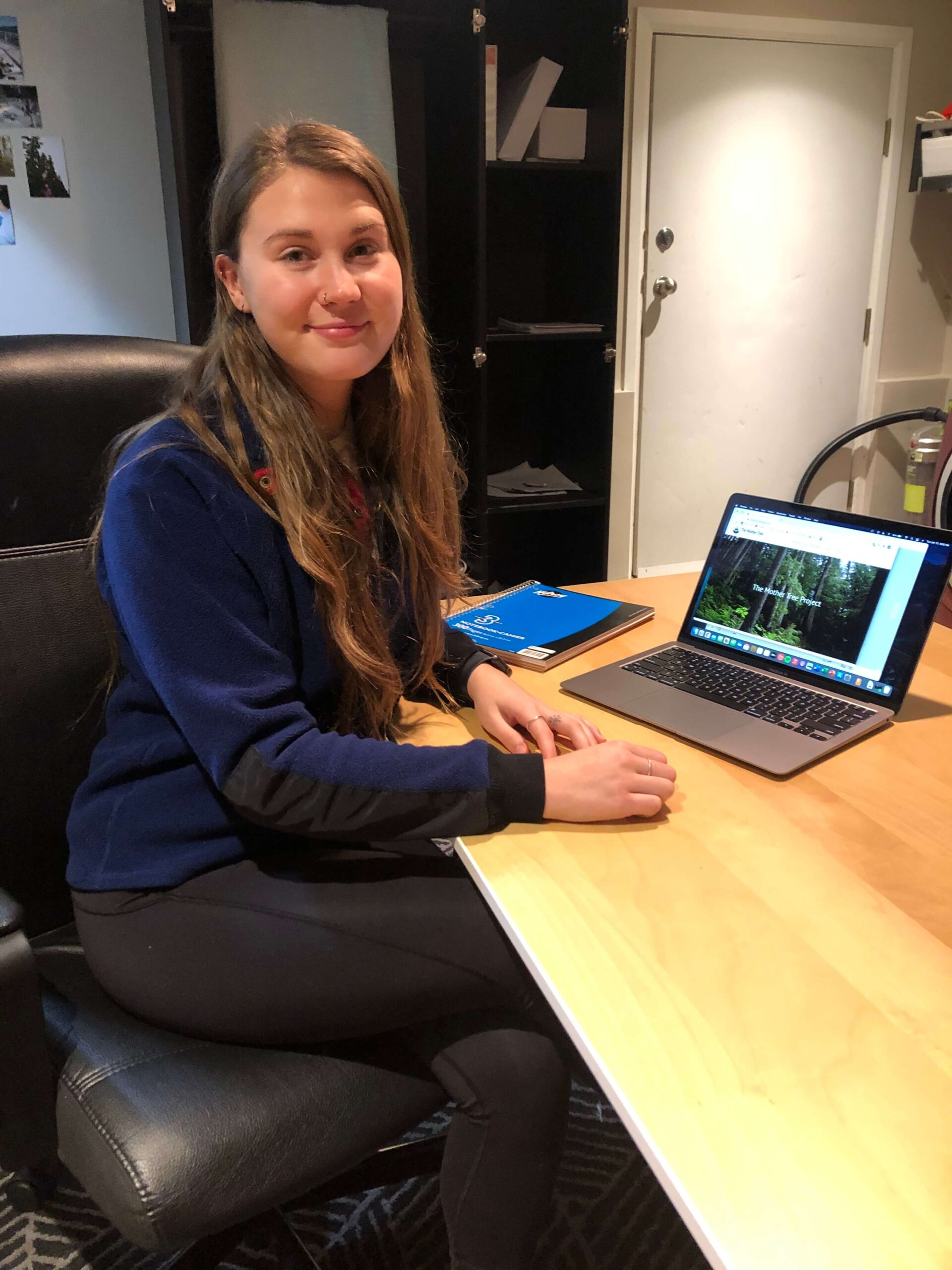 UBC Forestry Co-op Student Alyssa Robinson sits next to her laptop.