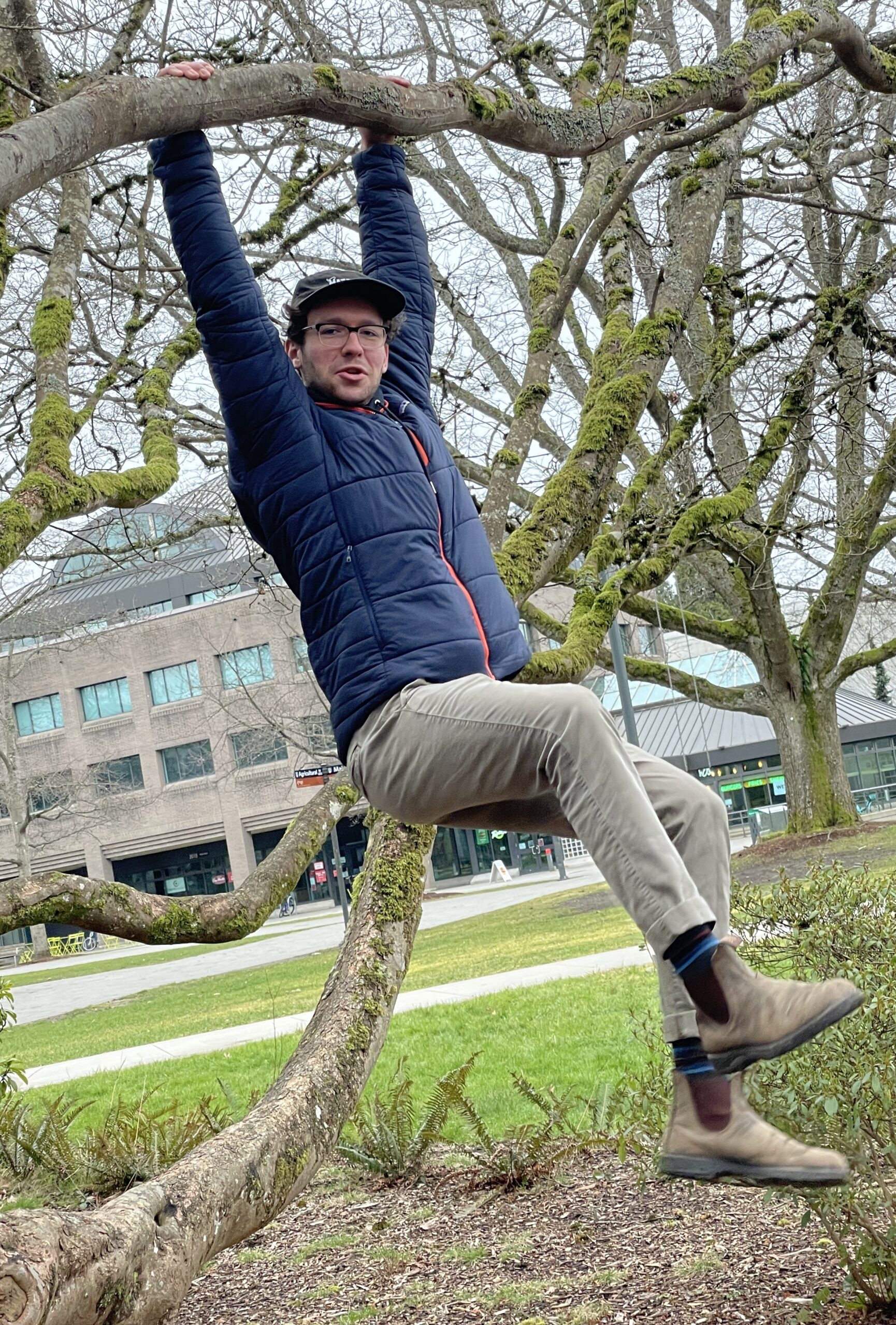 UBC Forestry Co-op Student Nicholas Mantegna swings on a tree at UBC.