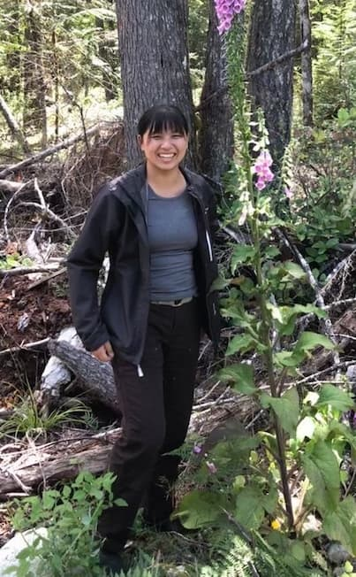 UBC Forestry Co-op Student Winnie Hsiao standing in the Forest during her work term.